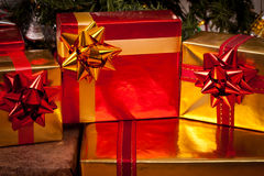 Decorated gift boxes under the Christmas tree Royalty Free Stock Photos