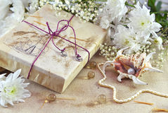 Decorated gift with flowers and pearl shell Stock Photography