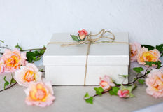 Decorated gift with roses Royalty Free Stock Photo