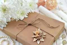 Decorated gift with white flowers and romantic things 2 Royalty Free Stock Photography