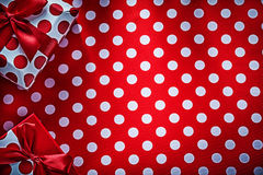 Decorated gifts on polka-dot red table cloth holidays concept Stock Image