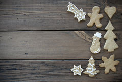 Decorated Ginger Bread Cookies on Wooden Plank Stock Photo