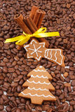 Decorated gingerbread and cinnamon sticks on coffee grains, christmas time Stock Photos