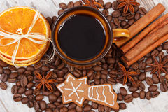 Decorated gingerbread, cup of coffee and grains, spices, christmas time Stock Images