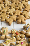 Decorated Gingerbread Men with Plain One in the Background Royalty Free Stock Photo