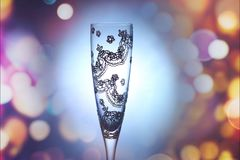 Decorated glass cup to give on big occasions. And surrounded by bright lights Stock Photography