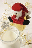 Decorated glasses at a christmas party. Glasses with santa claus and snowflake Royalty Free Stock Images