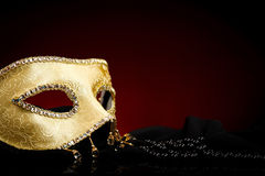 Decorated golden mask and pearls Stock Photo