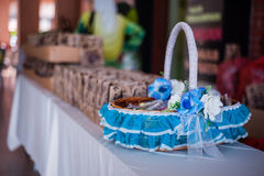 Decorated Goodies Basket. A decorated basket filled with goodies for wedding reception guests stock image
