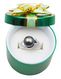 Decorated green box with black pearl in gold ring Stock Photo