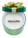 Decorated green box with wedding platinum ring Stock Photography