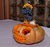Decorated halloween pumpkin with flowers and berries Stock Image
