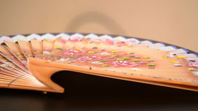 Decorated hand fan made in wood stock footage