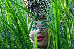 Decorated head of Brazilian women in grass Stock Photo