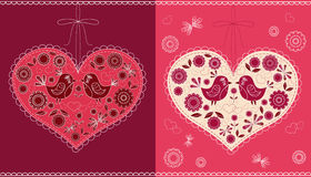The decorated heart with birds and flowers. Stock Photos