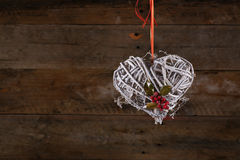 Decorated Heart Shape Christmas Wreath White Twigs Ribbon Holly Royalty Free Stock Photography