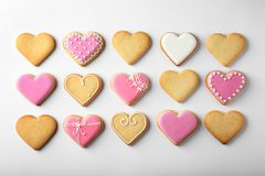 Decorated heart shaped cookies on white background. Top view stock photography
