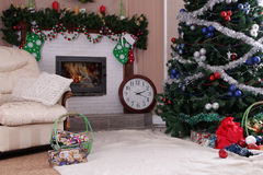 Decorated holiday home decor with fireplace and Christmas tree Royalty Free Stock Image