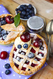 Decorated homemade shortcrust pastry berry pies Stock Photos