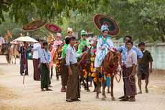 Decorated horse, buffalo and local people who participated in the donation channeled ceremony in Bagan. Myanmar, Burma Royalty Free Stock Photo