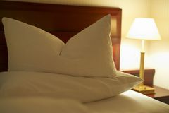 Decorated hotel bed Royalty Free Stock Photos