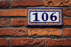 Decorated house number on brick wall in Europe. Bruges (Brugge), Royalty Free Stock Photo