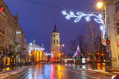Christmas Gediminas prospect, Vilnius, Lithuania. Decorated and illuminated Christmas Gediminas prospect and Cathedral Belfry during evening blue hour, Vilnius Stock Images