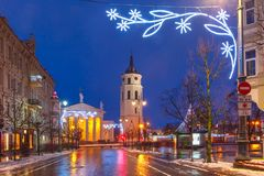 Christmas Gediminas prospect, Vilnius, Lithuania. Decorated and illuminated Christmas Gediminas prospect and Cathedral Belfry during evening blue hour, Vilnius Stock Image