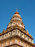 Decorated Indian temple. A beautifully decorated Indian temple against a bright blue sky Royalty Free Stock Images