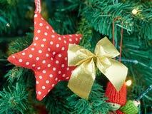 Decorated items hung xmas tree closeup Stock Photos