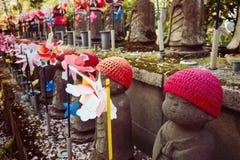 Decorated Jizo statue in Zojoji Temple, Tokyo Stock Photos