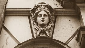 Decorated Keystone with Female Face. Low angle shallow depth of field sepia tone horizontal photography Stock Image