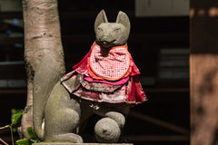 Decorated kitsune fox. Statue of decorated kitsune fox Royalty Free Stock Images