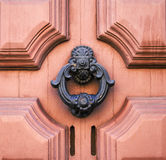 Decorated knocker on pink door Royalty Free Stock Image