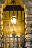 Decorated Lamp at Arc Door. Big decorative lamp at front of arc door in rome city, Italy Stock Image