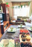 Decorated living room for breakfast party. Decorated living room for a surprise breakfast party Stock Photo