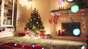 Decorated living room on Christmas night stock video