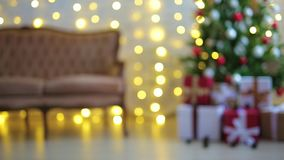 Living room with christmas tree, gifts and lights stock footage