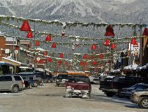 Decorated Main Street. This image of the street decorations and the snowy mountain in the background was taken in western MT Royalty Free Stock Image