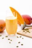 Decorated Mango Milk Shake And Crushed Cardamon Royalty Free Stock Images