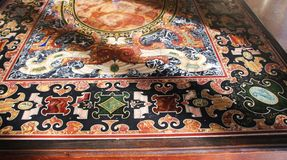 Decorated, marbled table in a museum in italy Royalty Free Stock Photos