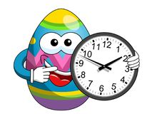 Decorated mascot easter egg indicating wall clock. Isolated on white Stock Images
