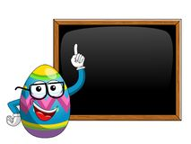Decorated mascot easter egg teaching blank blackboard or chalkbo. Ard isolated on white Stock Image