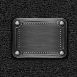 Metal badge on leather background Stock Photo