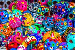 Decorated Mexican colorful skulls at market, Mexico stock photo