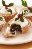 Decorated mince pies on plate close-up Stock Photo