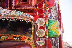 Decorated mirror of a truck. Backside decorated pakistani truck decoration art artist paint painter flower heart culture wheels auto bedford punjab jingle stock image