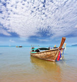Decorated native boat Longtail has dropped an anchor Stock Images