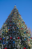 Decorated New Year tree at street Stock Photos