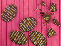 Decorated Novelty Chocolate Easter Biscuits. Against a Pink Background Royalty Free Stock Photography